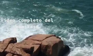 Man Hides Behind Rocks as Waves Come
