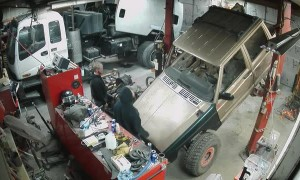 Jeep Falls off Lift in Shop
