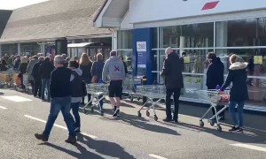 People Line the Block to Enter UK Store