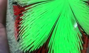 Glassblower Skillfully Crafts UV Reactive Sculpture Piece