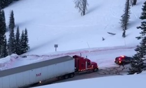 Police Car Pulls Truck Along Icy Road