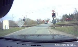 Impatient Bicycle Rider Almost Hit by Train