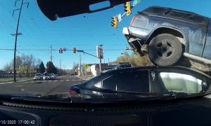 Red Light Runner Lifts Truck Onto Traffic