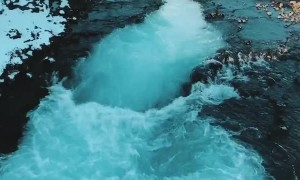Beautiful Bruarfoss Waterfall Swirls with Glacial Waters