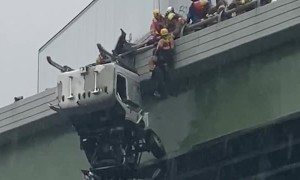 Driver Rescued From Truck Dangling off Bridge