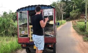 Tuktuk Tows Skateboarder