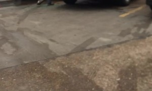 Man Smashes Car Window With a Shopping Cart