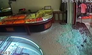 Boy Shatters Glass Door in Shop