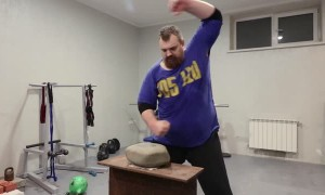 Russian Man Demonstrates Big Stone Hand Training