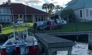 Crash Leaves Boat Beached in Backyard