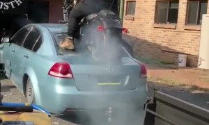 Biker Does Burnout on Back of Car