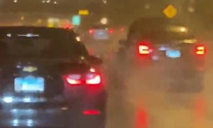 Car Speeds Down the Expressway with its Hood Up