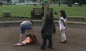 Kids Helping Each Other out at a Playground