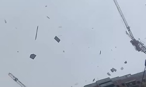 Building Materials Fly Off a Building During a Storm