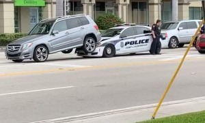 Cop Car Stuck Underneath SUV After Collision