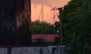 Multiple Waterspouts Wind Down From Sky During Storm
