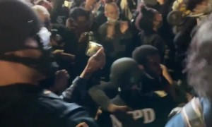 Sweet moment between protester and cop at Barclays