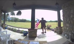 UPS Driver Stops to Fix Flag