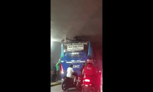 Boys Extracted from Bus Top in Tight Underpass