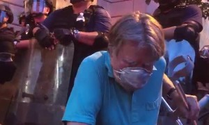 Frail Man Takes a Knee on the Front Lines of Protest