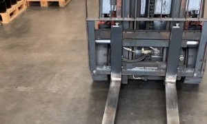 Picking up 50 Pence with a Forklift