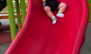 Baby Slips Slowly Down Slide