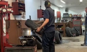 Mechanic Teaches Buddy How to Put the Tire on Quick