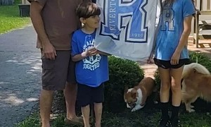 Corgi Interrupting Family Photo