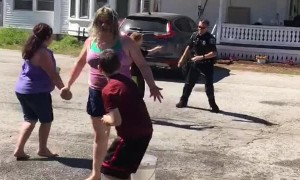 Kids Enjoy Water Balloon Battle With Police Officer