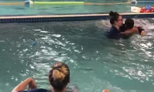 Baby Learns How to Swim at Early Age