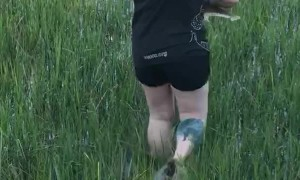 Woman Saves Juvenile Bonnethead Shark from Tall Grass