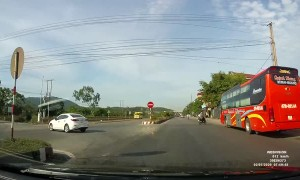 Sudden Swerve Causes Motorist to Climb Curb