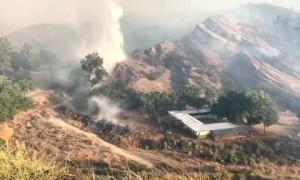 Water-dropping helicopters fight to put out Soledad Fire in California