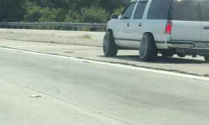 Wheel Rolls Along Freeway After Falling Off SUV