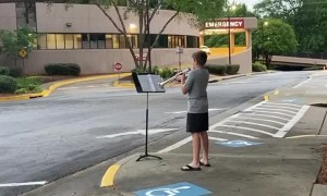12-year-old boy plays trumpet for healthcare workers