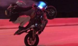 Professional Rider Wheelies with Fireworks