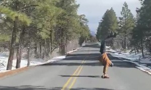 Man Handstands on Longboard down Grand Canyon Roadway