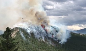 Helicopters engage in direct aerial attack on the Elephant Butte Fire in Evergreen, Colorado