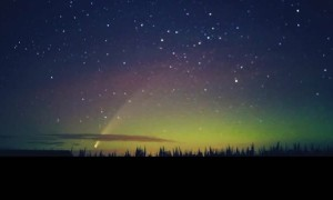 Comet Drifts Though Northern Lights