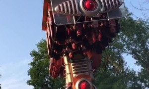 Amusement Park Ride Stops Upside-Down