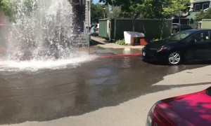 Driver Causes Massive Splash after Uprooting Fire Hydrant