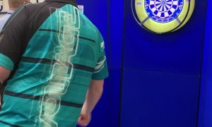 Boy Plays Darts with Professional Player Rob Cross