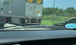 Man Clings to Truck at Highway Speed