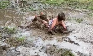 Kiddo Plays in Mud Puddle