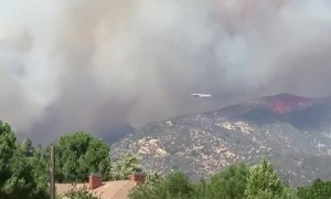 Amazing footage of huge airplane attempting to put out Apple Fire