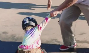 Young Girl Learning to Skateboard with Coach
