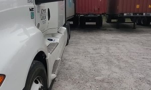 Semi Squeezes Into Tight Spot to Weather Storm