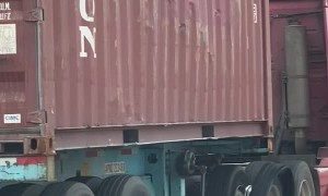 Truck Drives Along Highway With Major Damage