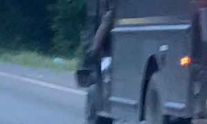 Wholesome UPS Driving Swinging Leg at Work