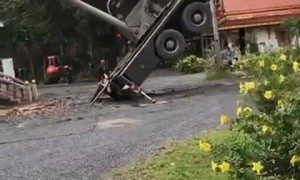 Crane Crushes Crematorium